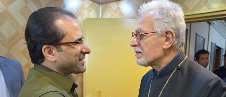 Iraq's Deputy Interior Minister Aqeel al-Khazali (left) greets Archbishop Vicken Aykazian of the Armenian Apostolic Church in the United States, during the visit of an ecumenical delegation to al-Khazali's office in Baghdad on January 21, 2017.